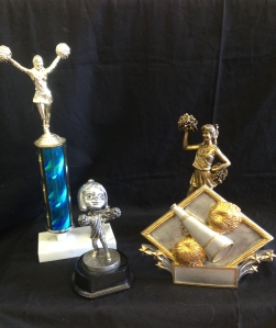Cheerleading Trophies in Stock: Blue Trophy- $12.50 Bobble Head- $10.95 PDU- $14.25 Risen- $18.25